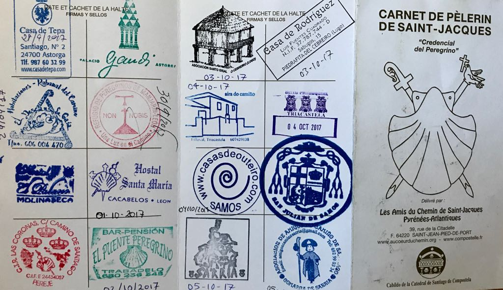 A pilgrim passport, showing some of the stamps inside