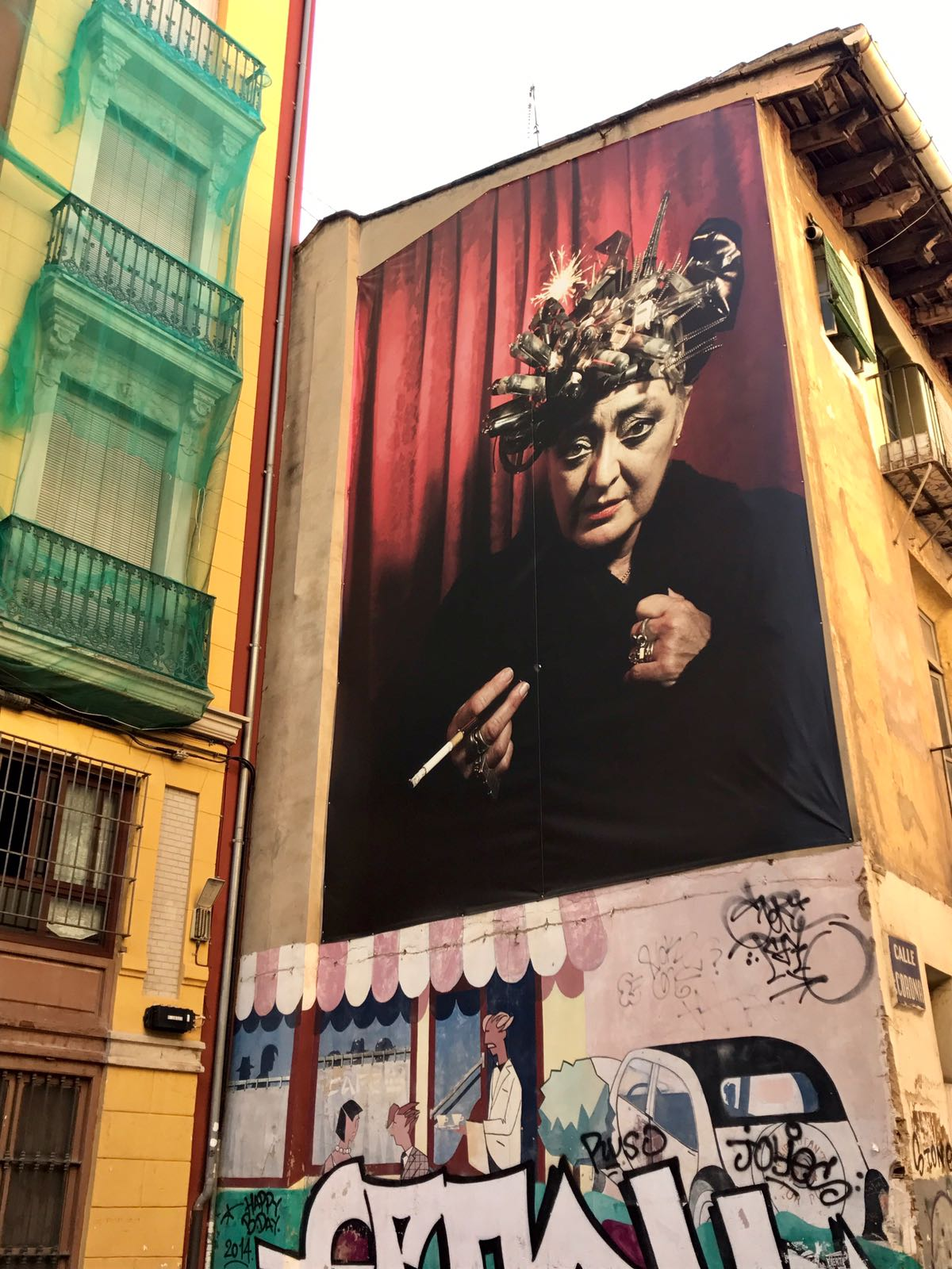 Photo poster of an older woman smoking a cigarette with what look like robotic hair curlers on her head