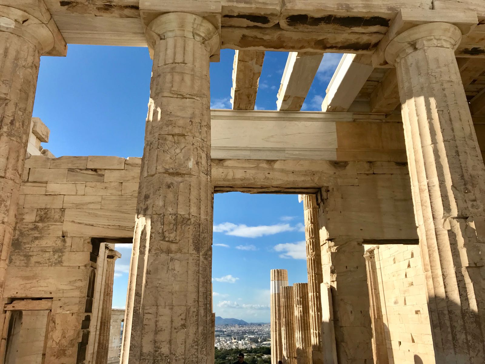 View from inside the Propylaea in the Acropolis with the blue sky showing through the gaps