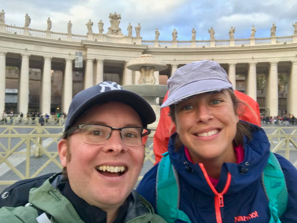 Roz and Tom in St. Peter's Square happy because they've finished the Francigena