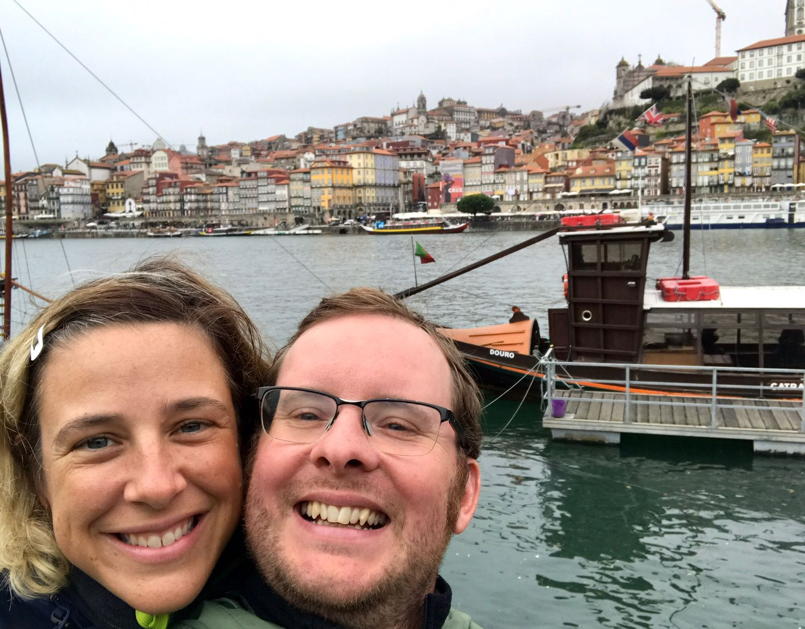 Roz and Tom grinning in front of the Douro river