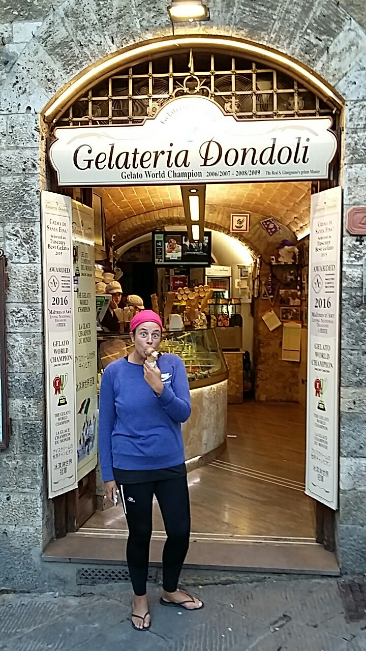 Roz eating an ice cream from Gelataria Dondoli with a happy but surprised look on her face