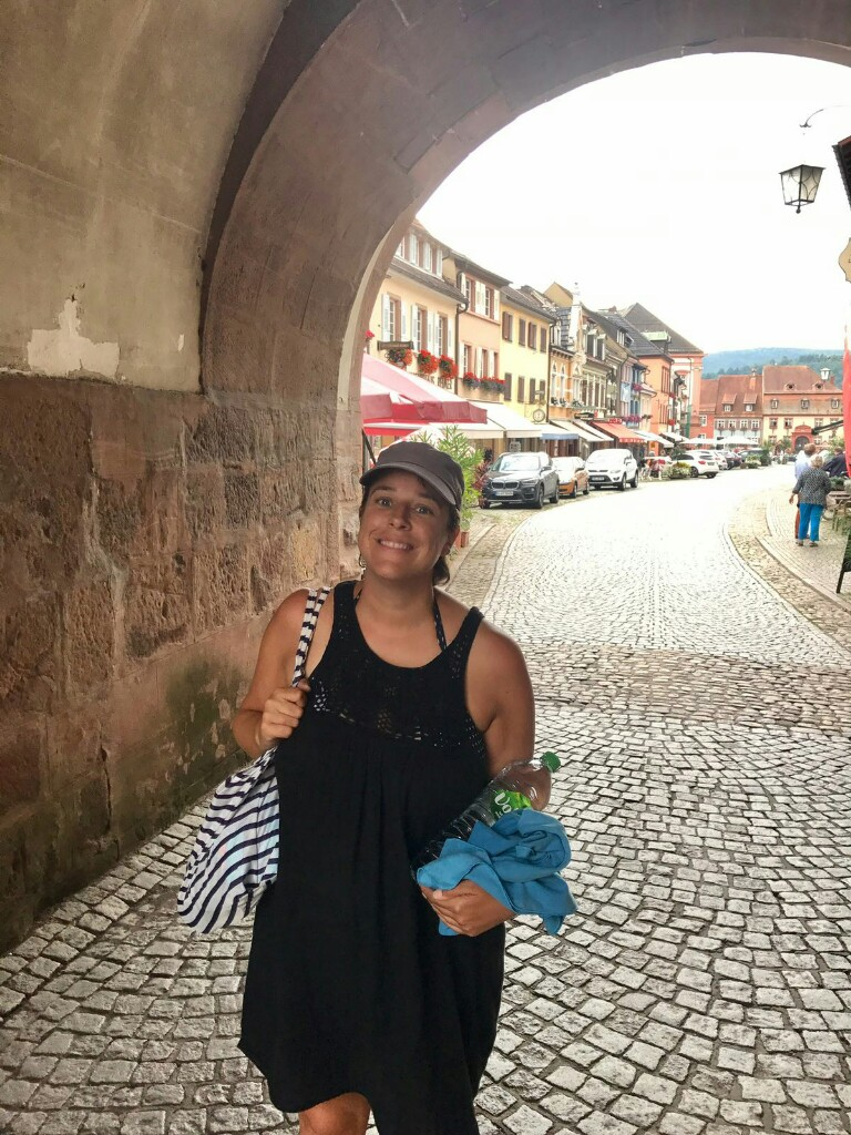 roz in an archway in pretty Gengenbach