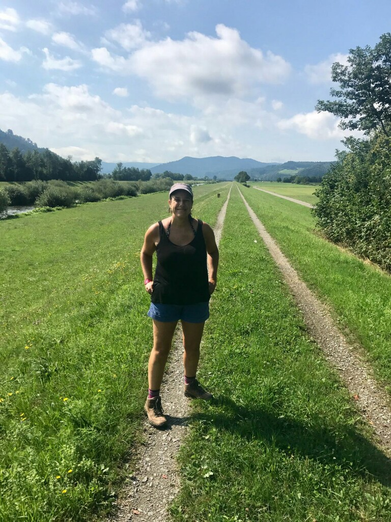 Roz on path alongside the Kinzig river made of two dirt trails going off into the far distance