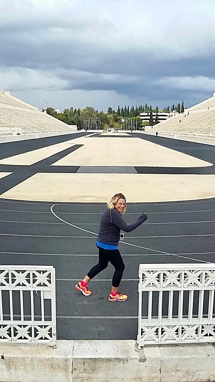 Roz pretending to run along the track of the Panathenaic Stadium