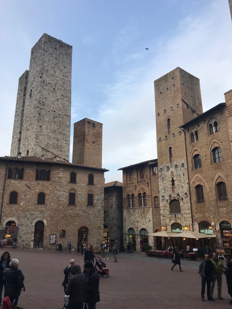 Towers in piazza della erb showing the buildings they all grow out of