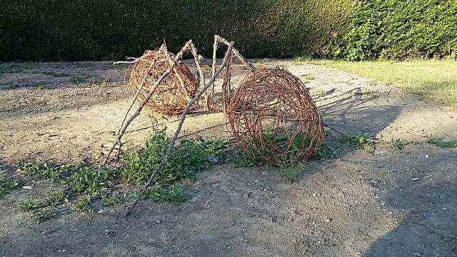 Sculpture of an ant made from twigs