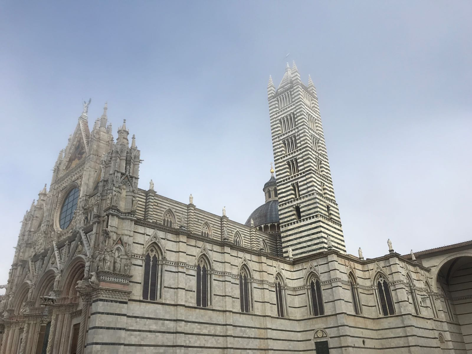 Siena Cathedral in the mist with the facade and tower fading into the background