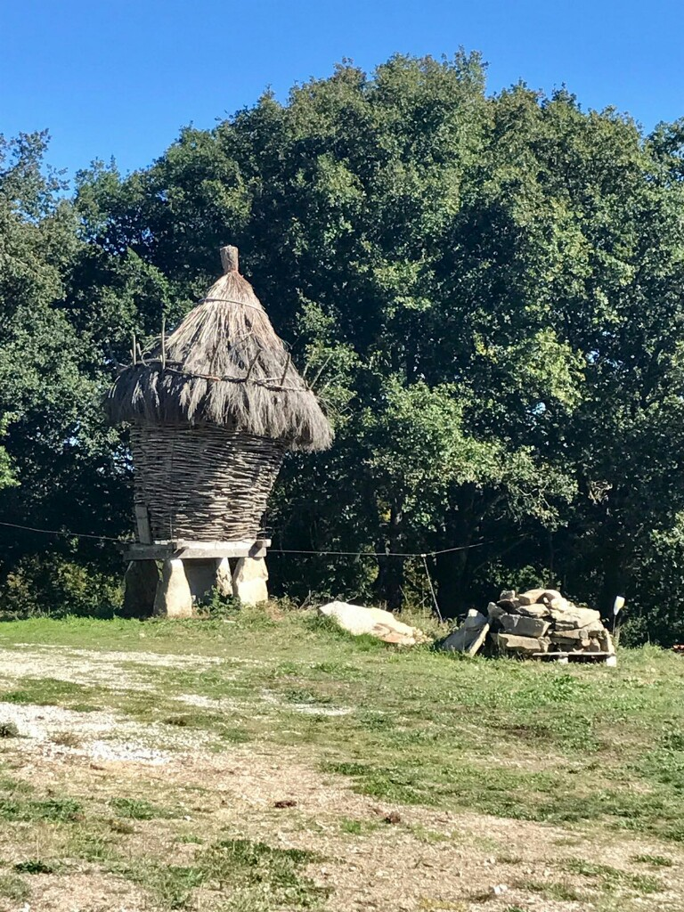 Small straw house still being woven