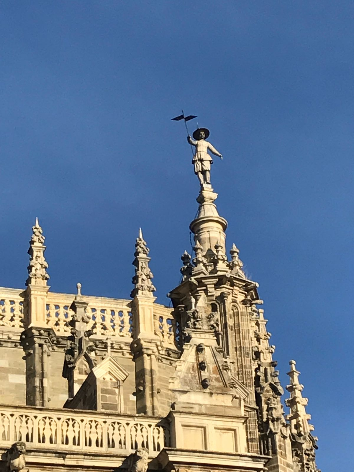 A statue at the top of one of Astorga cathedral's spires