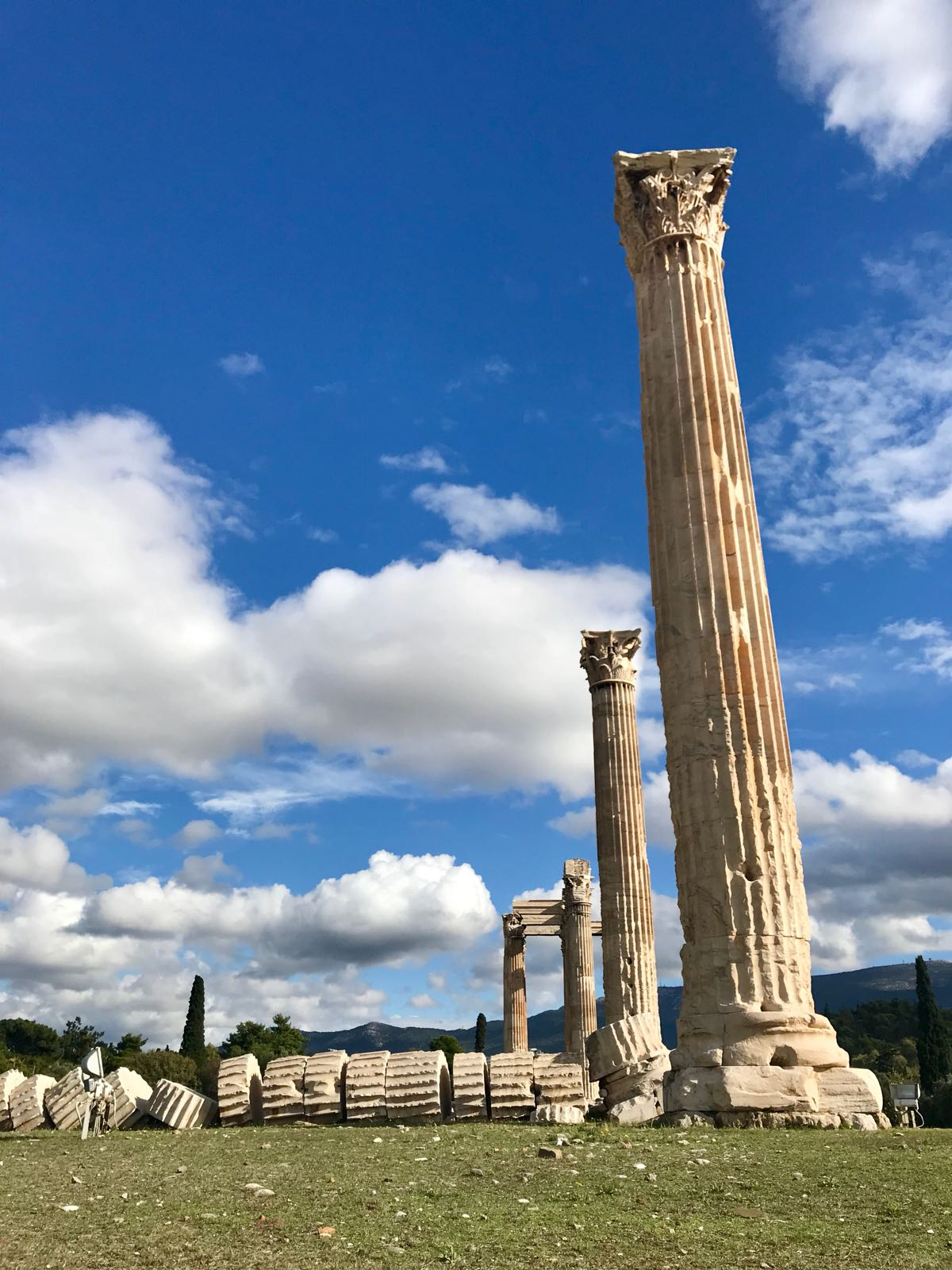A line of columns at the temple of the Olympian Zeus with one fallen and split into the individual discs that make them up