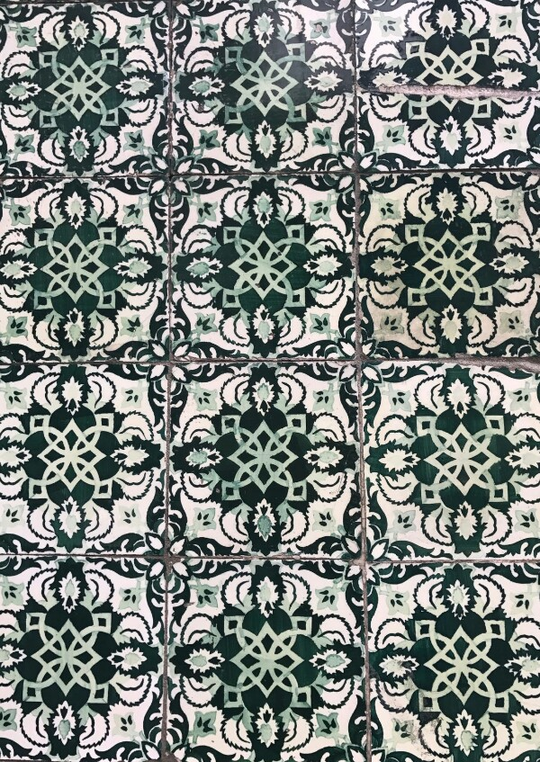 Dark green tiles with a white and light green pattern