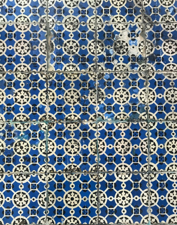 Tiles with a white geometric pattern on a blue background