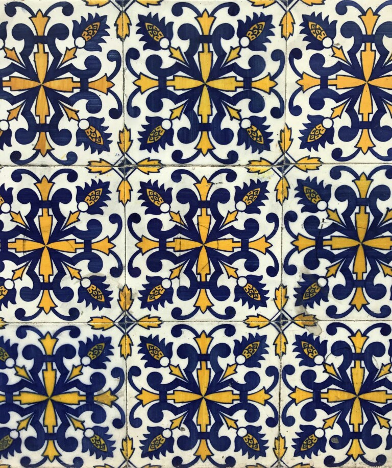 Tiles with a centralised yellow and blue pattern on white background