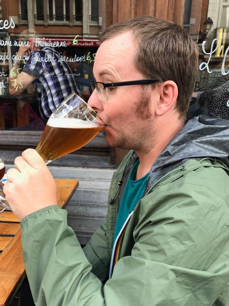 tom drinking beer