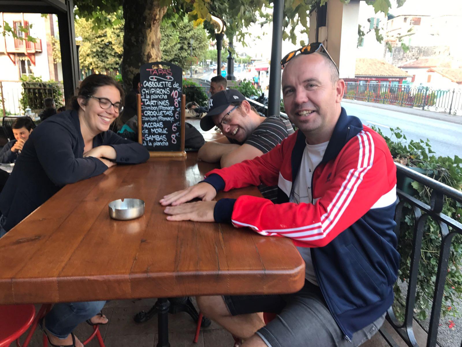 Tom, Fanny and John sharing a joke in a restaurant in Saint Jean Pied de Port