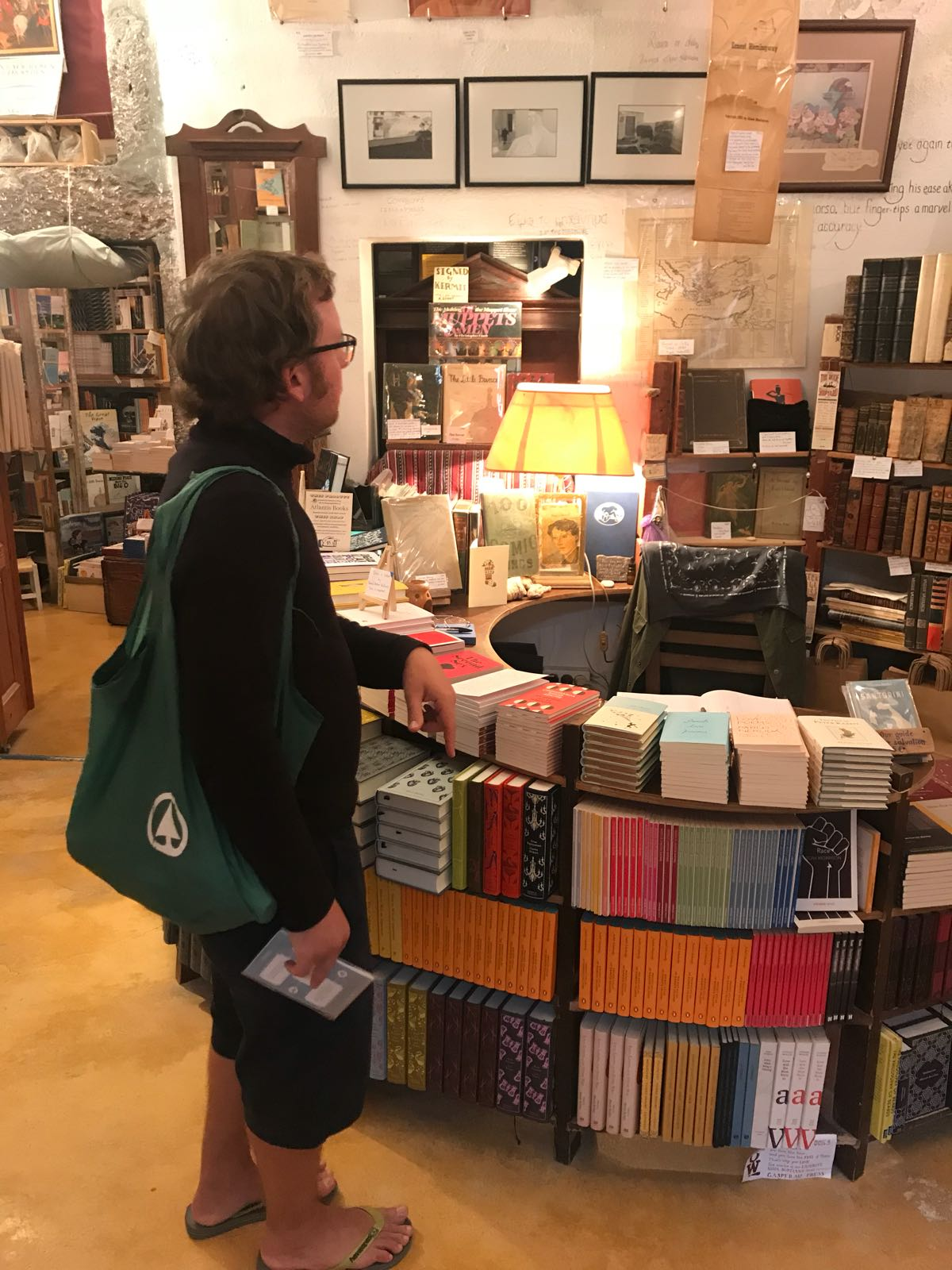 Tom browsing the collection in Atlantis books