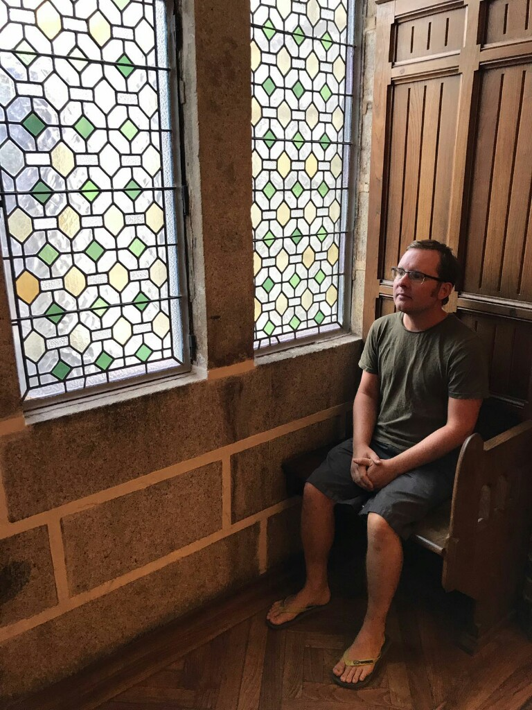Tom in a window seat in the Episcopal Palace