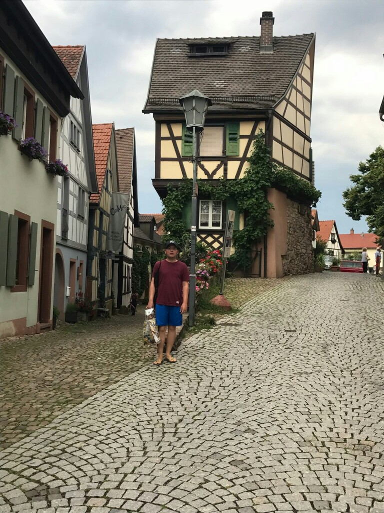 tom in a Gengenbach cobbled street surrounded by old, colourful houses