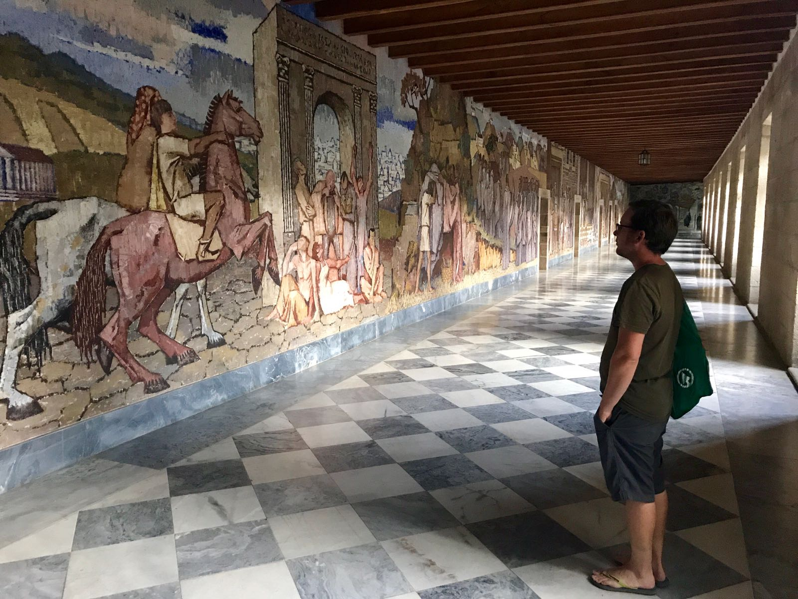 Tom looking at the monastery murals