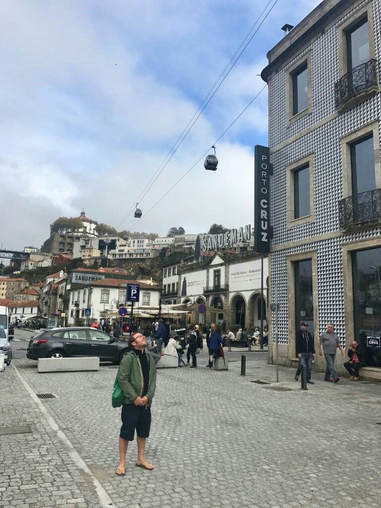 Tom on the south side of the River Douro with cable cars overhead
