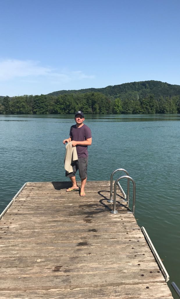 tom standing on a wooden pier on the rhine