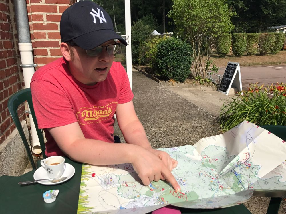 Tom with a map and a coffee, planning the day's route