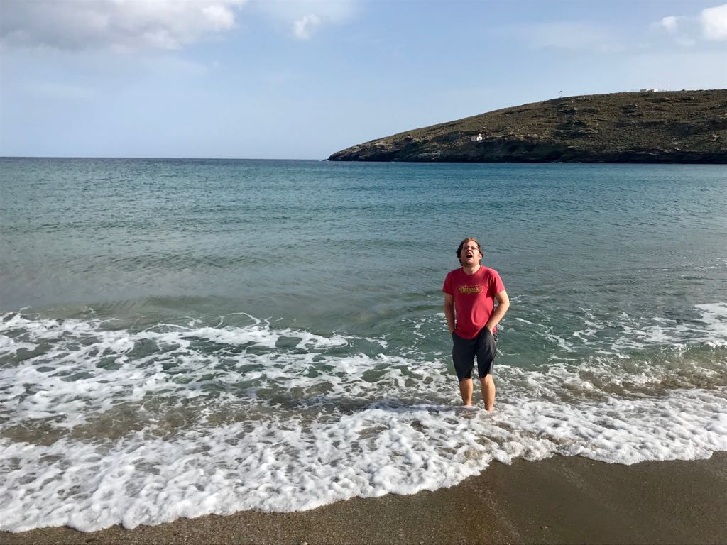 Tom with screwed-up face reacting to standing in the sea at Andros