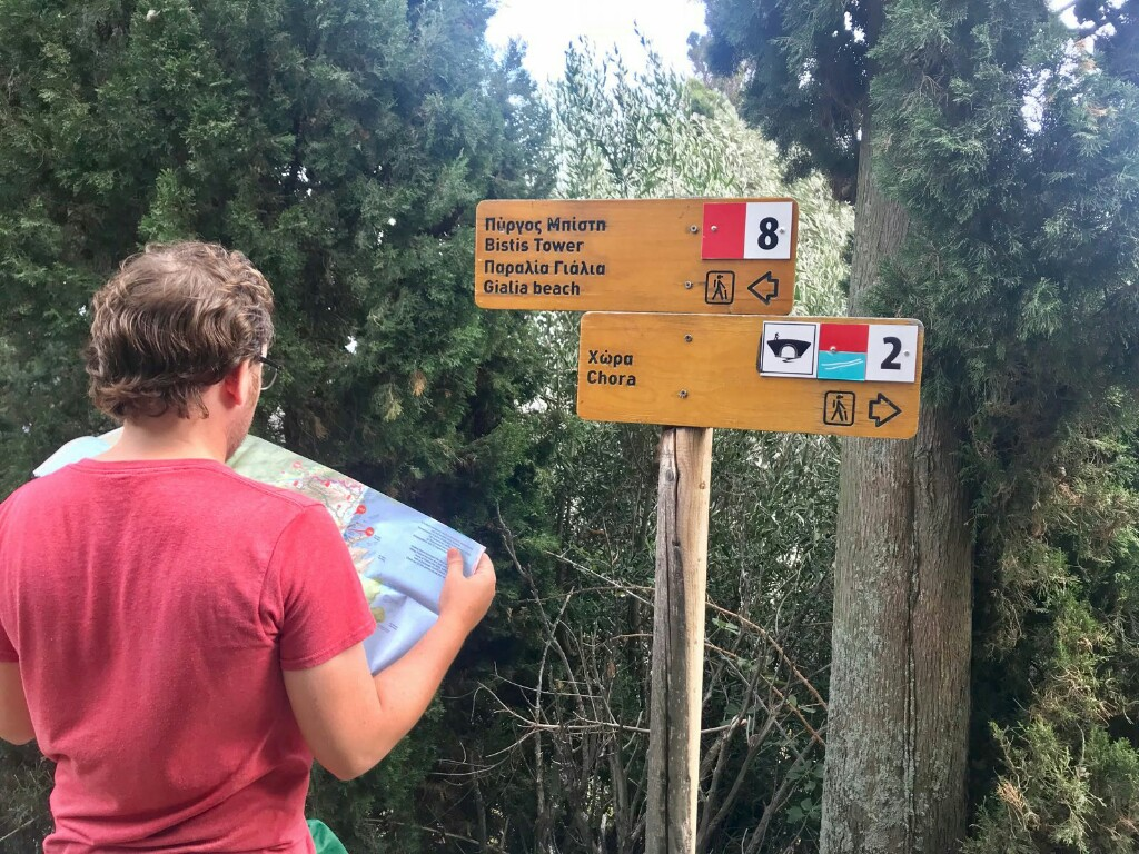 Tom checking signs to two different walking routes on Andros