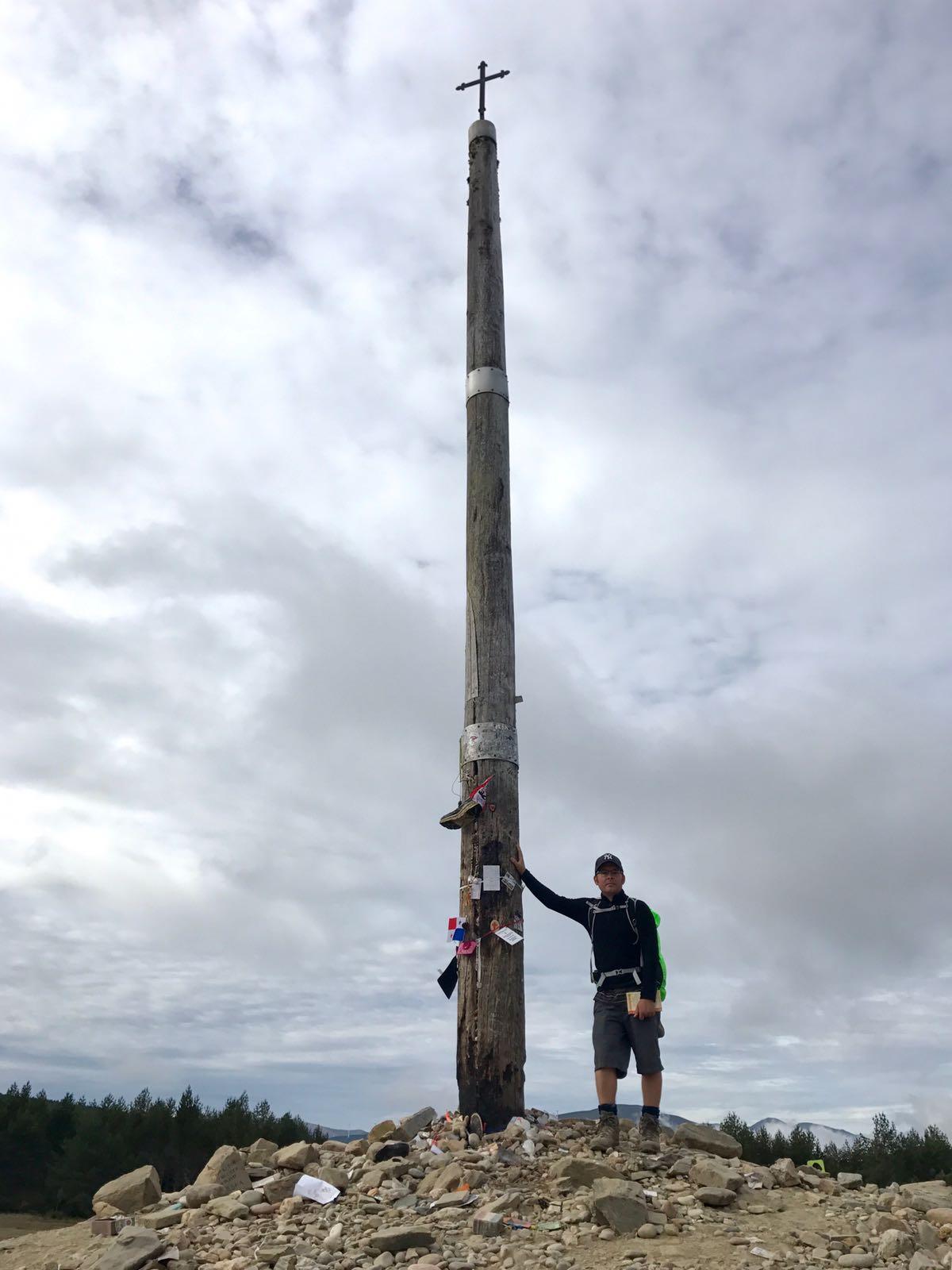 Tom standing next to the iron cross