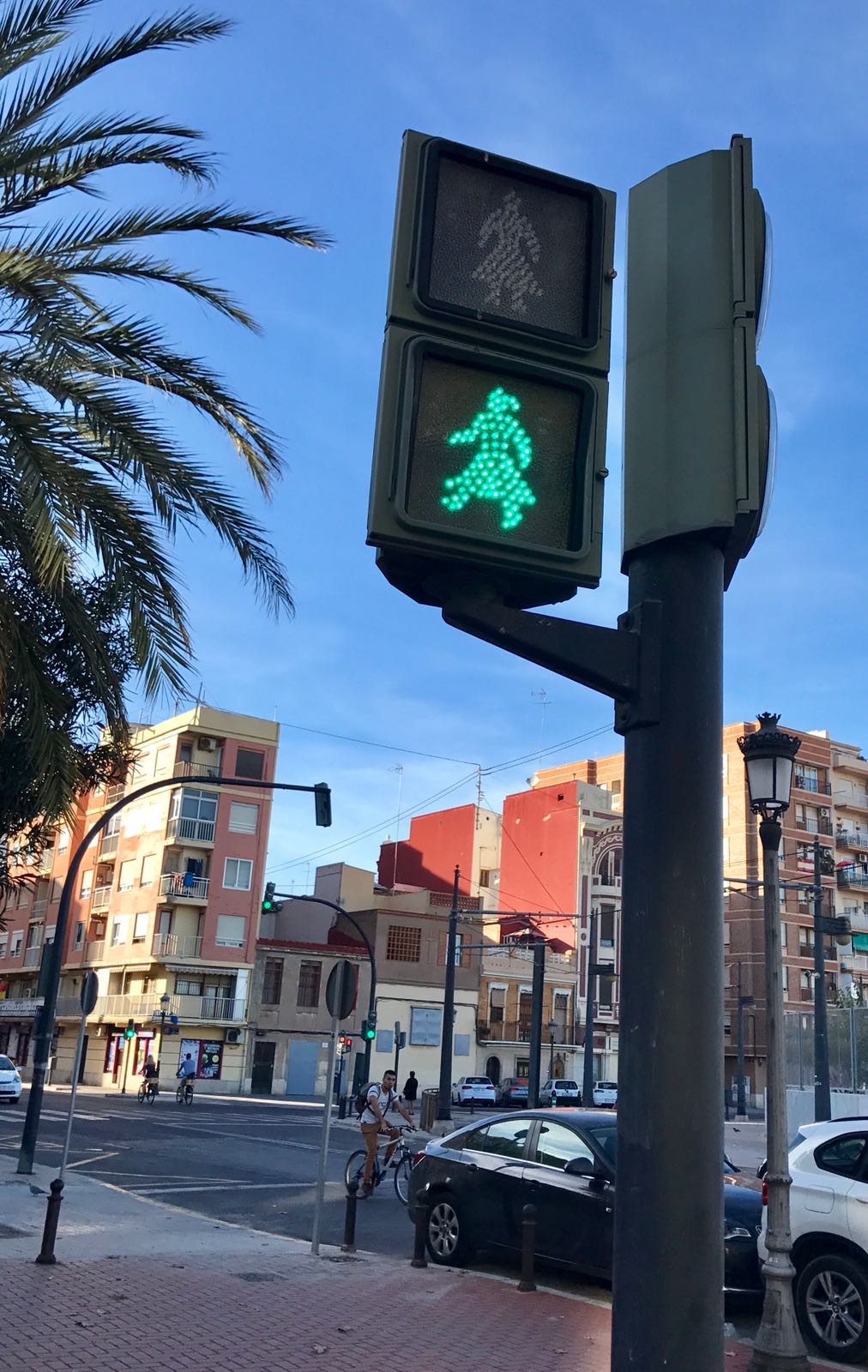 Traffic light on green with the symbol to walk being a woman