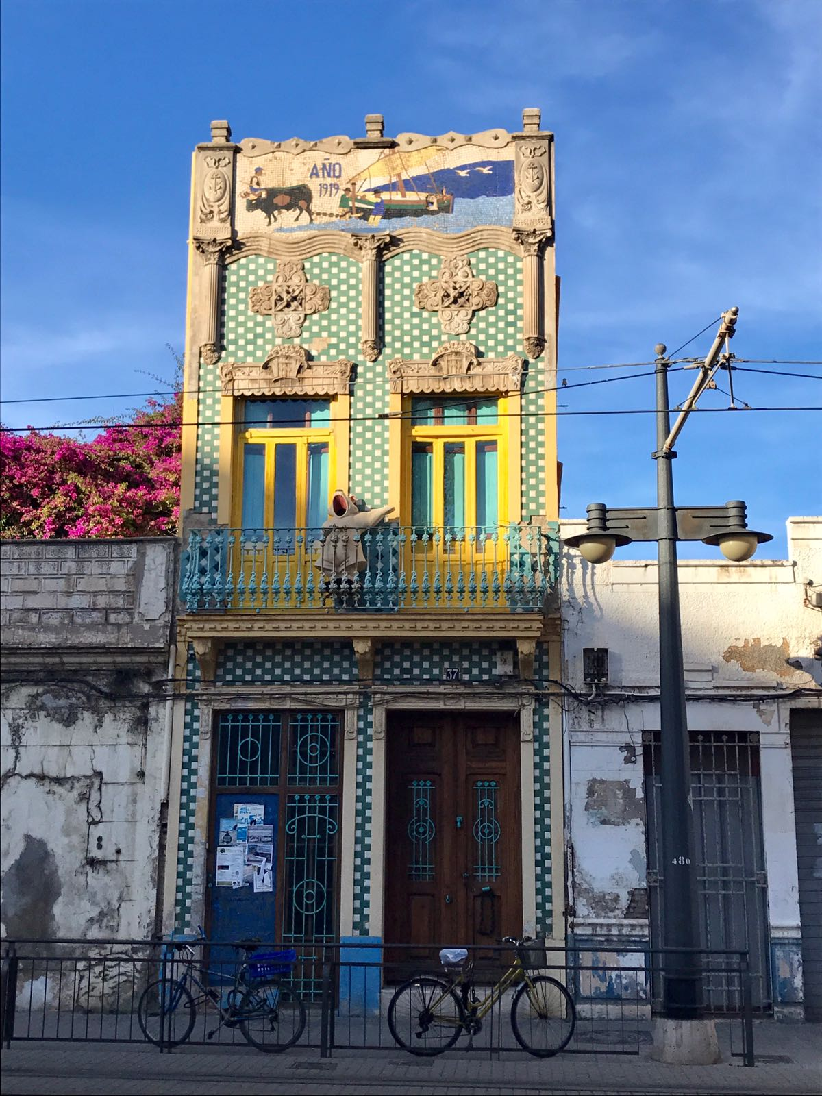 Yellow and blue tiled terrace building in Valencia by the beach