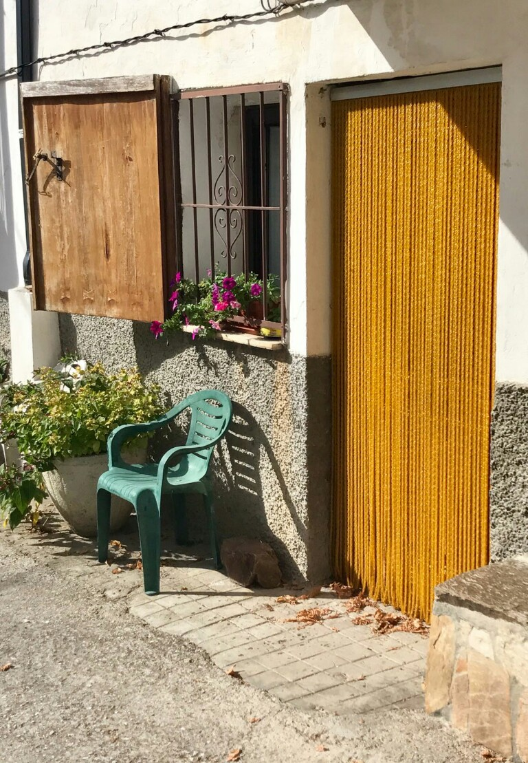Village house with yellow beaded curtain