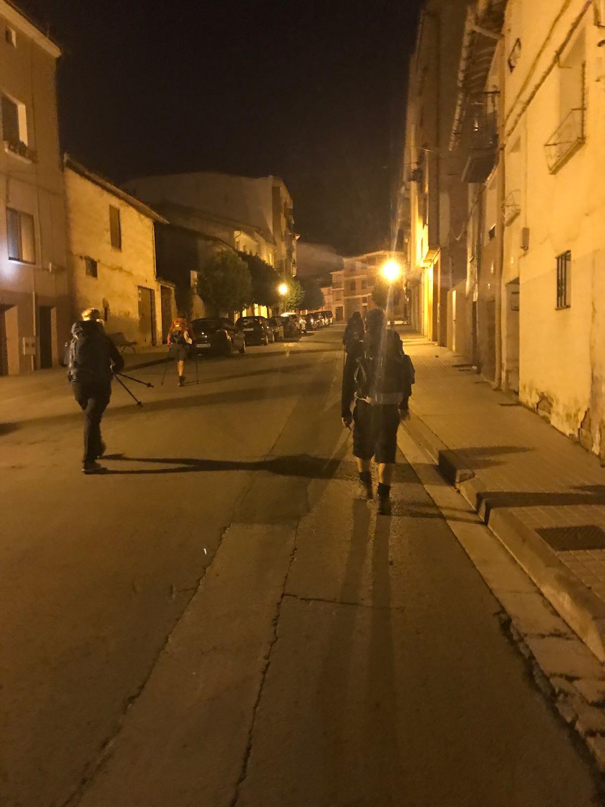 Walking through town before sunrise