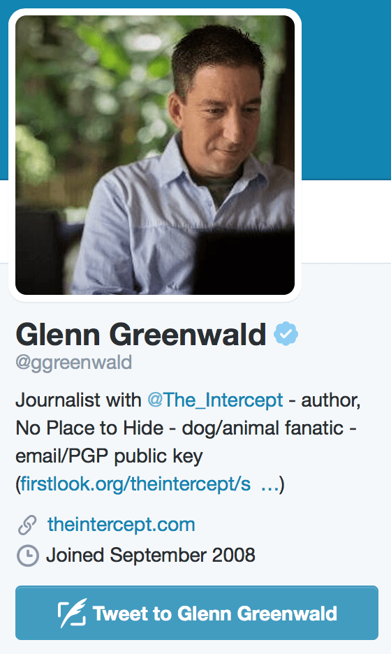Glenn Greenwald's Twitter bio, which includes a link to his PGP public key.